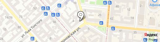 Золотая монета на карте Одессы